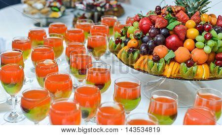 Exotic Fruit Dish with Mint Jelly. Dragon Fruit, Maracuya, Starfruit, Cantaloupe and Berries