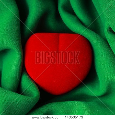 Red Jewel Box Heart Shaped Gift Present On Green Fabric Wavy Cloth