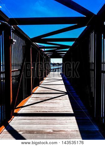 industrial bridge with abstract scene framing the Mississippi River
