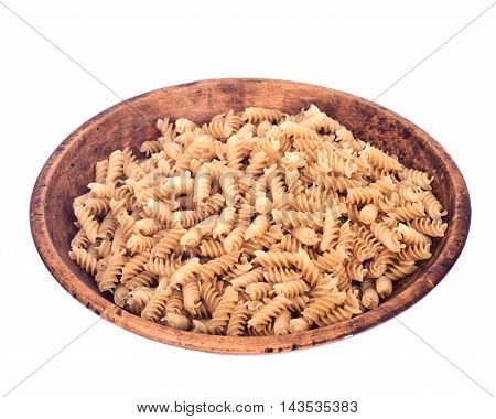 Organic italian rice pasta in wooden bowl