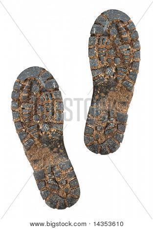 Schlammigen Sohlen der Wanderschuhe, isolated on White.