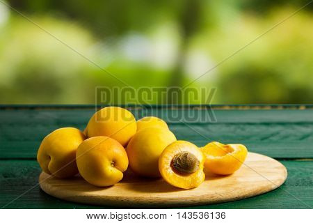 Apricots on a wooden table. Still life with apricots.