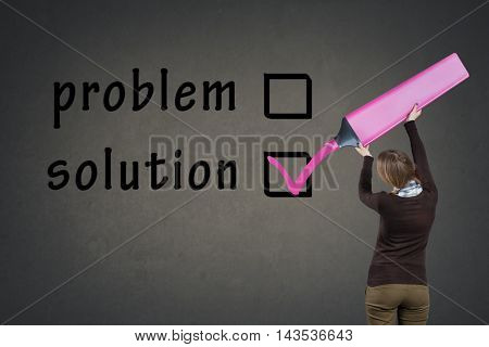 Girl with big marker vote problem or solution, back view