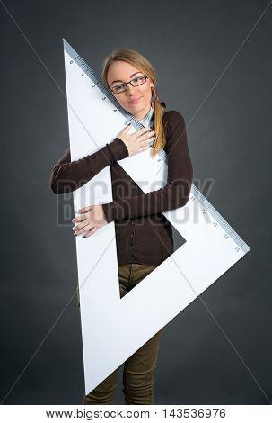young student girl hugging big ruler