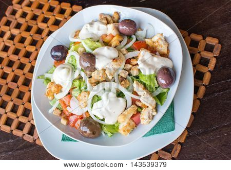 Caesar Salad In A Bowl In Restaruant