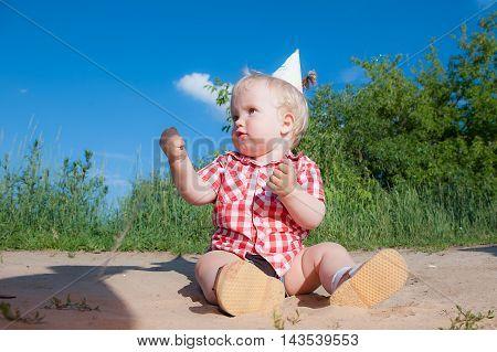 Litle boy on playground in summer park