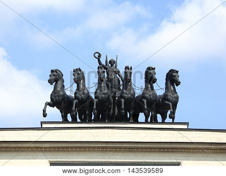 Cast iron sculpture depicting the goddess of victory Nike in a chariot drawn by six horses