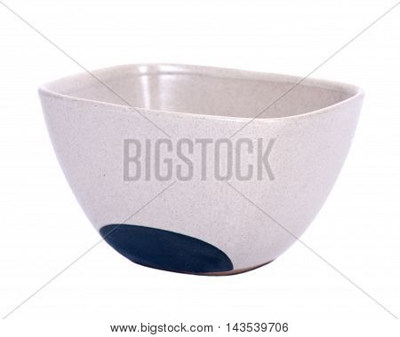 Empty ceramic bowl separated on white background