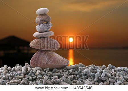 Balance stone on pile rock of sunset background in the eveningconcept of peace and Zen.