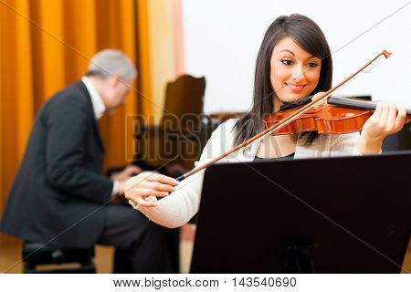 Beautiful woman playing violin