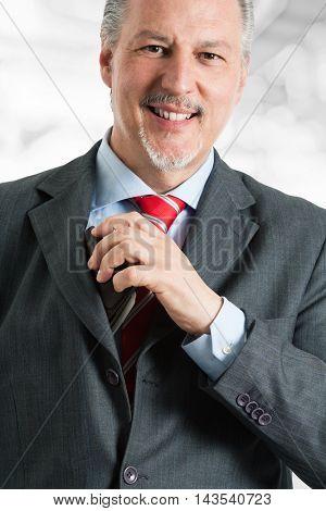 Mature man paying a bill