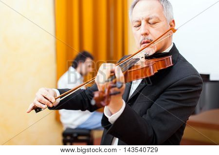 Close-up of a musician playing his violin