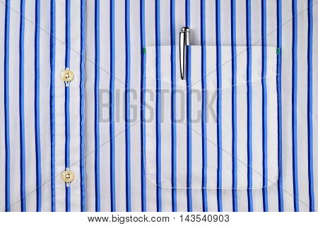 Pen in a classic blue striped shirt pocket