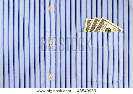 Dollar bills in a classic blue striped shirt pocket