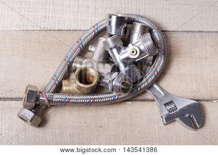 Construction tools on wooden table .Sanitary engineering background . Top view.
