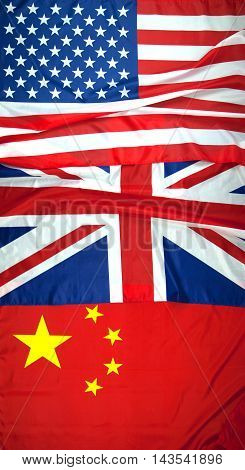 American British and Chinese flags arranged in order that can be used to show order of countries winning the games. America first with gold United Kingdom second with silver and China third with bronze.