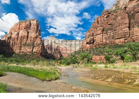 Clouds passing over the mountains and river Virgin beneath them in Zion National Park. Utah, United States of America