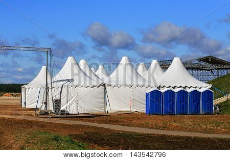 White awnings and other items of equipment for arrangement of exhibition