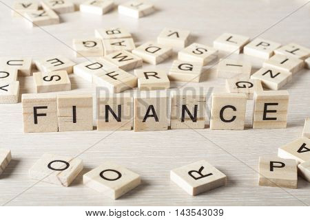 Wooden Blocks with the text: Finance. Wood ABC