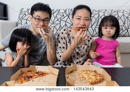 Happy Asian Chinese Family Eating Pizza Together