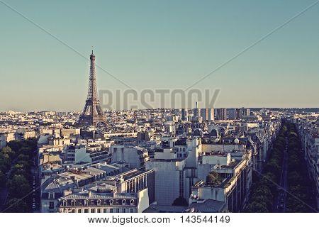Vintage looking Paris skyline with Eiffel Tower and buildings