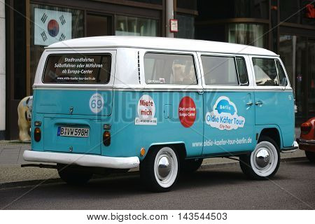 BERLIN, GERMANY - JUNE 21: An old VW Bus is available for rental for sightseeing tours in Berlin Potsdam Square on June 21, 2016 in Berlin.