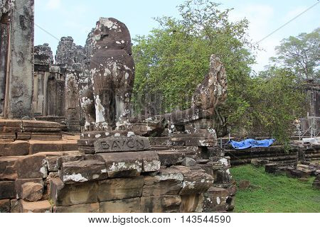 The Hindu/Buddhist Temple called Bayon in Cambodia.