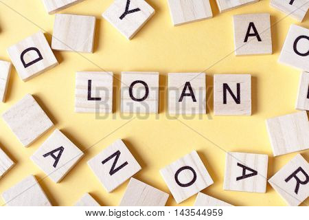 Wooden Blocks with the text  Loans. Wood ABc.