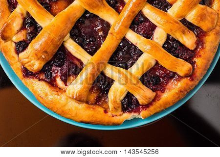 Cherry Pie With Lattice Top On Fall Themed Napkin