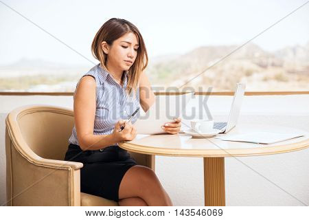 Pretty Businesswoman Reviewing Documents