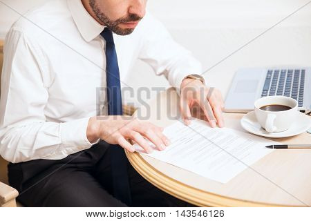 Businessman Reading A Contract At Work