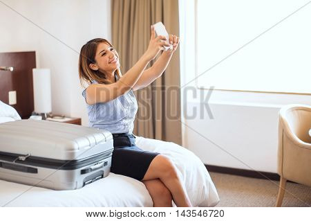 Taking Selfie Of Her First Business Trip