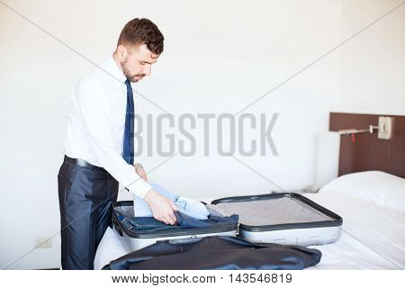 Businessman Packing His Bags In A Hotel