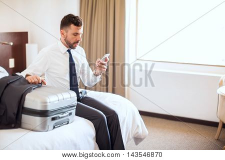 Businessman Requesting Taxi In A Hotel