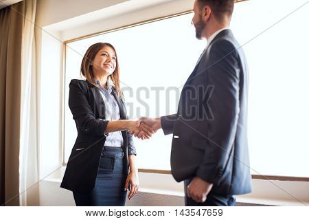 Female Manager Shaking Hands With A Coworker