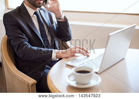 Very Busy Businessman At Work