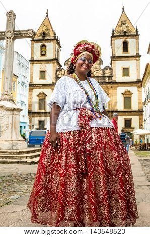 Brazilian woman of African descent wearing traditional clothes in Pelourinho, Bahia
