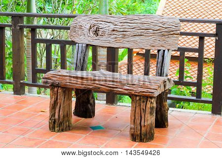 Wooden chairs on the porch background .