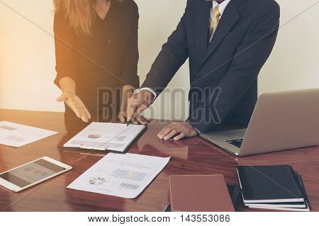 two business persons plan a project in office.