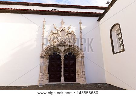 Main portal of the Saint Sebastian (Igreja Matriz de Sao Sebastiao) in Ponta Delgada Sao Miguel Azores Portugal. Two lateral doorways of the main portal.