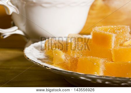 jujube fruit candies on a white plate tracery