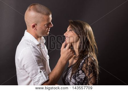 Young Couple 20 Years Old Kissing Boy Girl Man Woman Black Background Hand On Girl Face Head Smiling