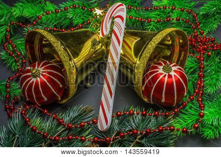 Christmas Decorations, Two Golden Bells And Red Balls On Fir Branch