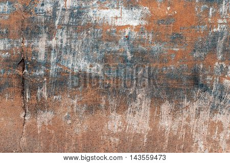 Texture of blue and orange wall with cracks
