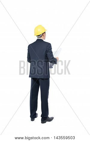 Back view of businessman in formal wear and red helmet holding blueprint. isolated on white background