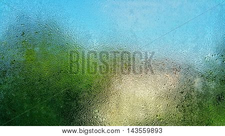 RAINDROPS ON WINDOW, BLUE SKY AND RAINDROPS