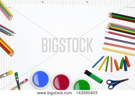 Frame of art supply against spiral notepad