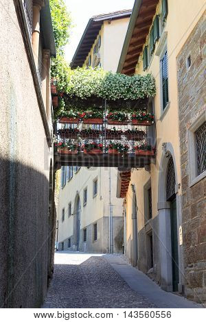 Typical Small Alley With Flowers In Upper City Citta Alta Of Bergamo, Italy