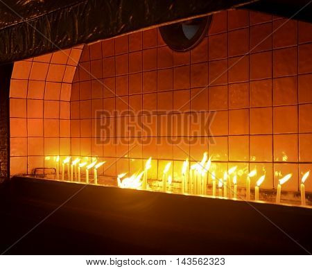 Candles in Church Worship. A votive candle or prayer candle is
