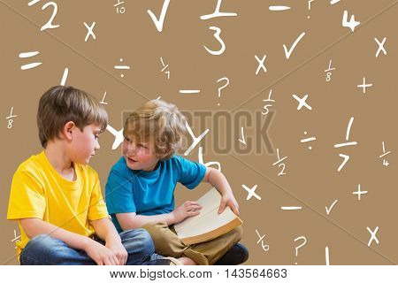 Pupils reading book against maroon background